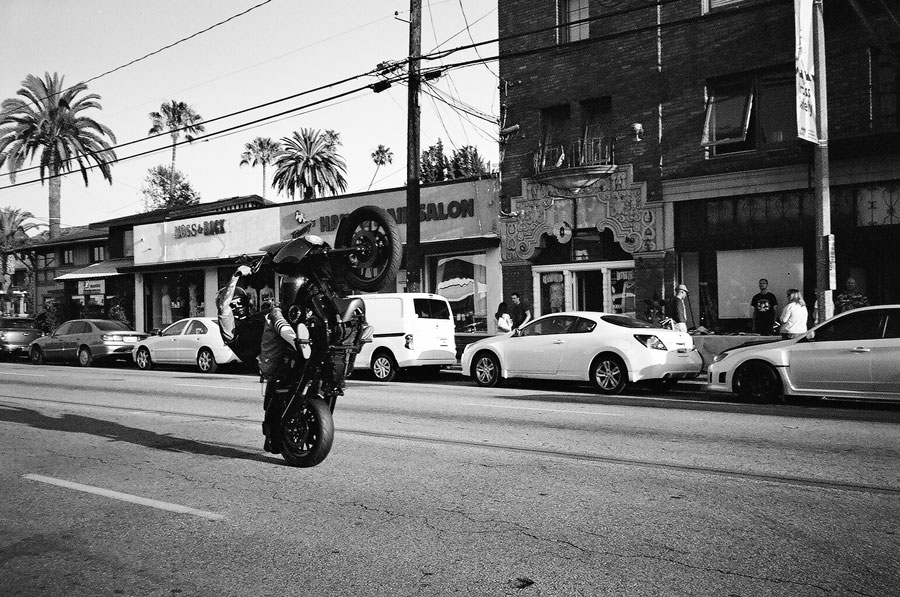 Wheelie down Broadway in Long Beach